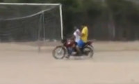 soccer goalkeeper hitches ride on motorcycle