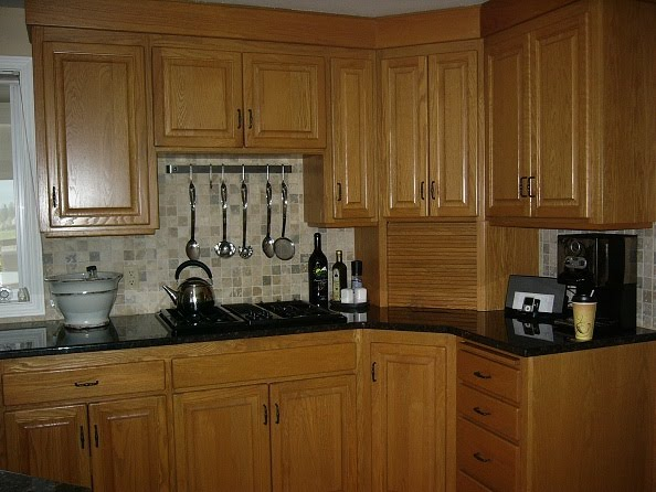 Shades of amber goodbye oak cabinets hello beautiful for Annie sloan chalk paint kitchen cabinets