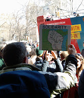protester with Wisconsin solidarity map sign