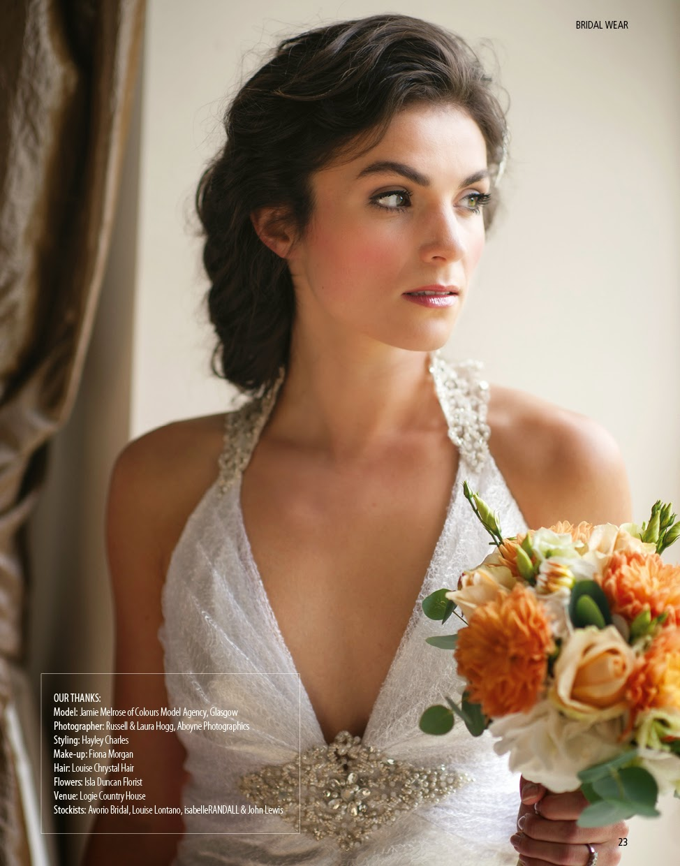 loosely braided and pinned up bridal hairstyle for a natural romantic wedding