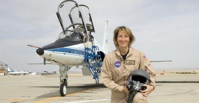 Kelly Latimer in front of a T-38 Talon. Photo Credit: NASA
