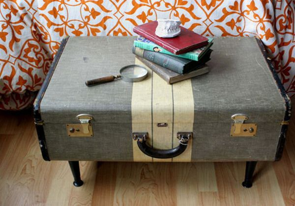 This vintage suitcase bench paired with classic books adds elegance to the space.