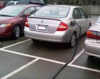 Funny pictures: car with hose of a gas station
