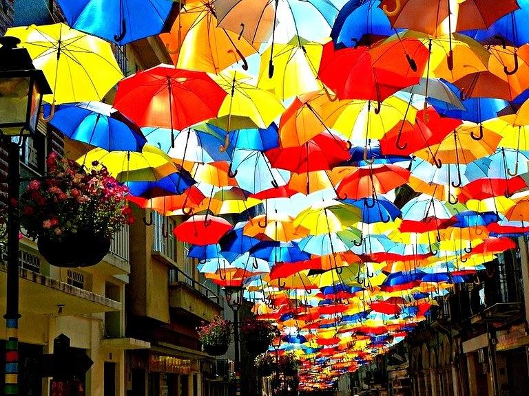 colourful floating umbrella installation agueda portugal art festival agitagueda studio ivotavares patricia almeida photographer the flying tortoise 001 - Colorful Umbrella  Covers Street in Agueda, Portugal