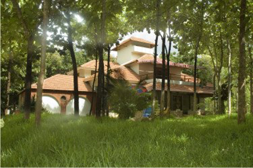 Anand Dham with its stepped Mangalore-tiled roofing nestled amidst nature