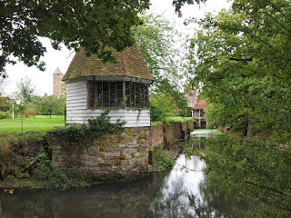 Moat and boat house in the garden at Sissinghurts