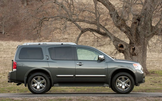 Side view of gray 2011 Nissan Armada in rural setting