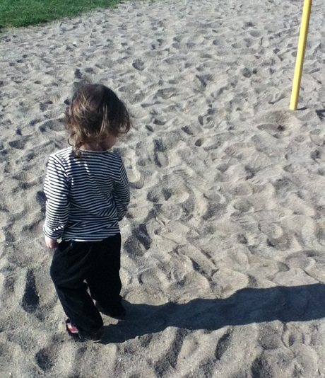 My daughter playing chase the shadow.
