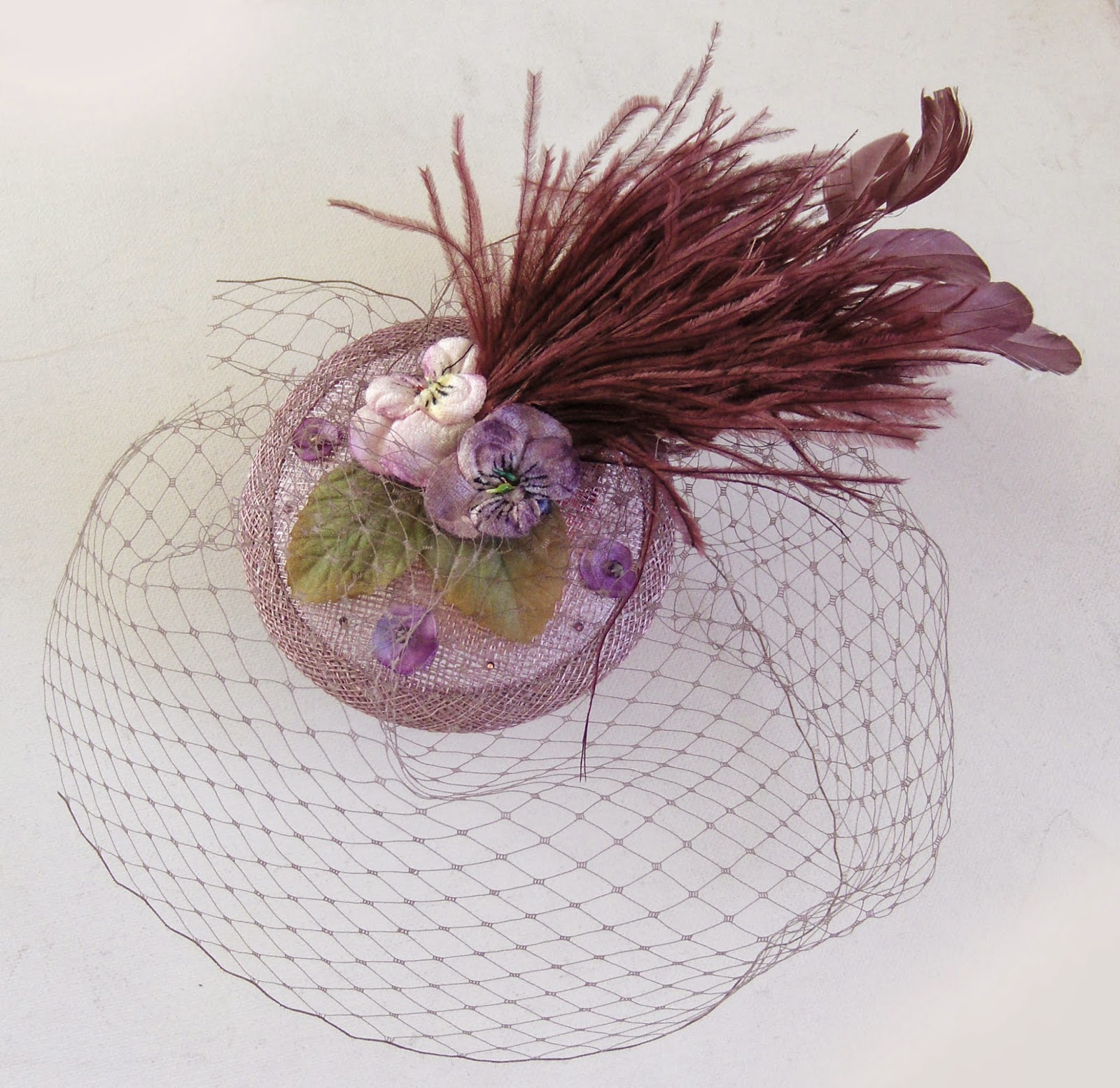 https://www.etsy.com/uk/listing/175176494/lilac-heather-cocktail-hat?ref=shop_home_active_11