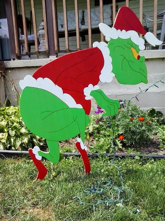 48 sneaking grinch stealing christmas lights yard art for Christmas yard ornaments