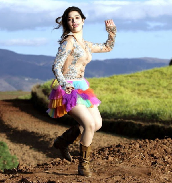 Tamanna in Multi-Colored Short Skirt and Leather Boots showing her Milky Thighs