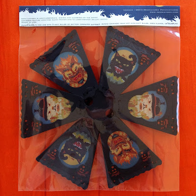 A packaged lantern by Bindlegrim (lower view) features the creeps - black cat, scarecrow, and devil