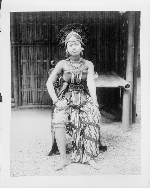 Photos of Female Javanese dancer, full-length portrait, seated, in costume, Paris Exposition, 1889