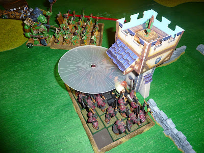 A Warhammer Fantasy Battle Report between Warriors of Chaos and Savage Orcs.