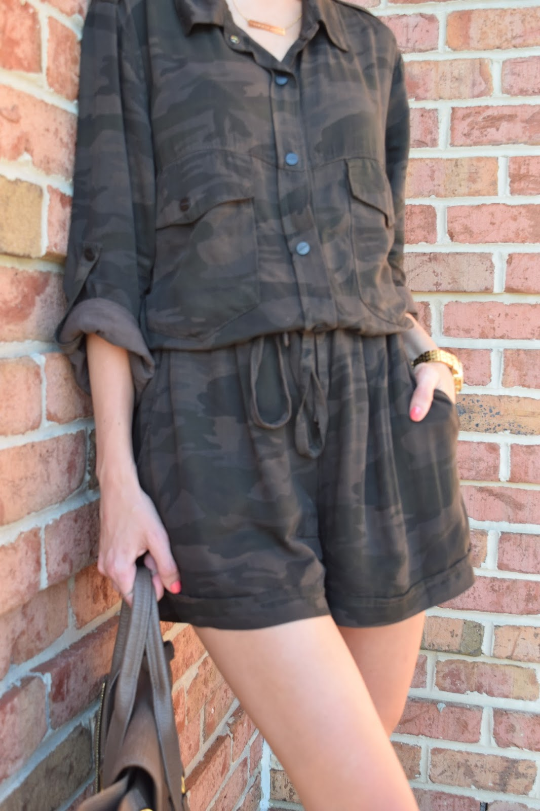 wearing sanctuary camo romper, gold gladiator sandals
