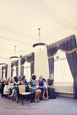 guests waiting for the bride in the purple room at Marylebone Town Hall wedding