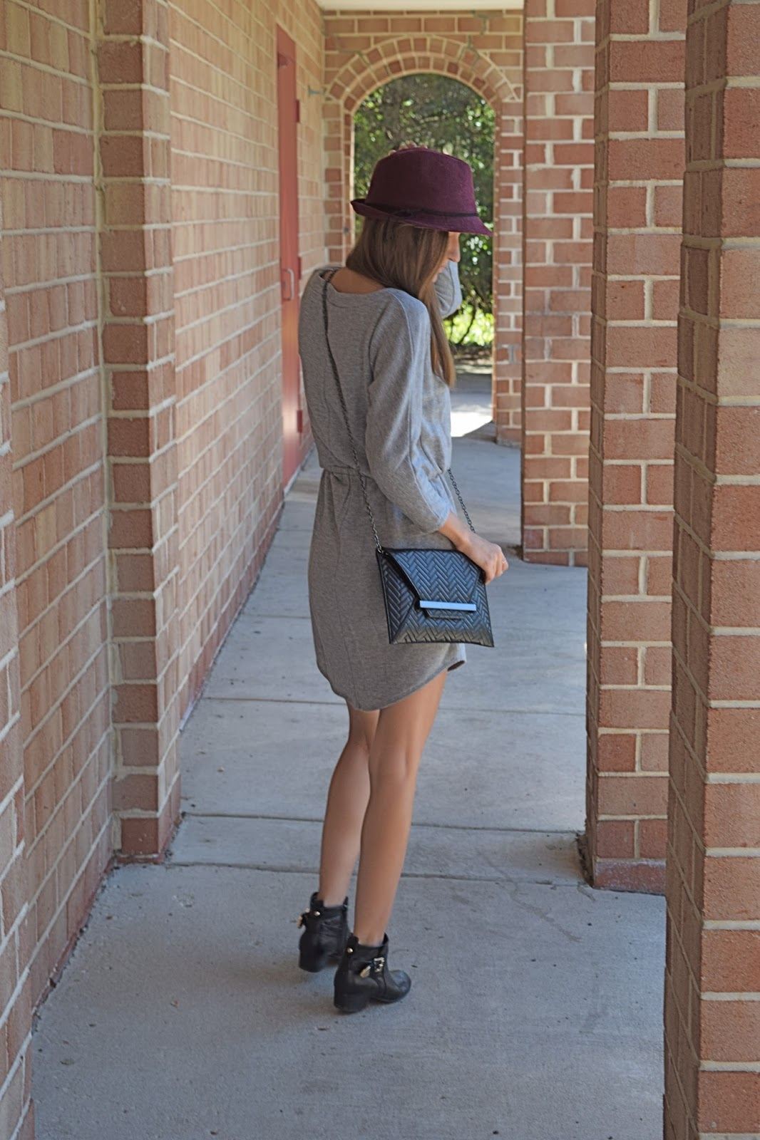 Wearing gray sweatshirt dress, Halogen burgundy felt fedora, black ankle booties with shirt dress