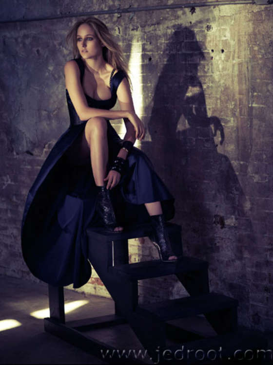 Leelee Sobieski sitting in a black dress
