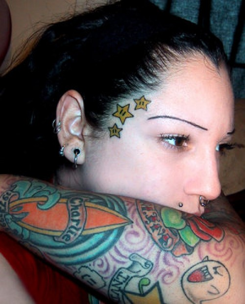 Labelleveg tattoo face tattoos for hot girls 2012 new for Girl with star tattoos on face