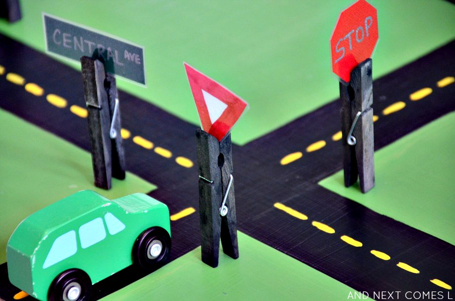 DIY road signs for car play: homemade toys that encourage fine motor development from And Next Comes L