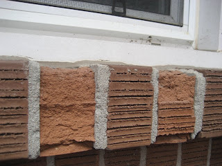 Spalling Brick on Window Sill