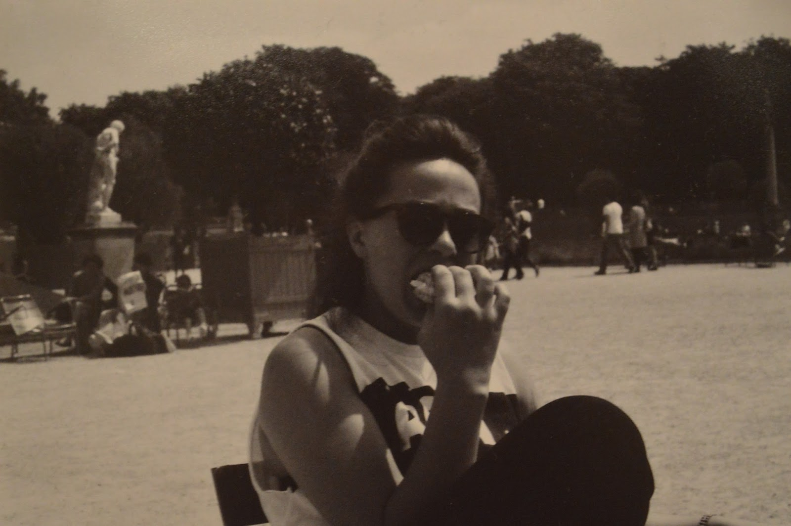 Photography: Girl eating macaroni in Luxembourg gardens, Paris