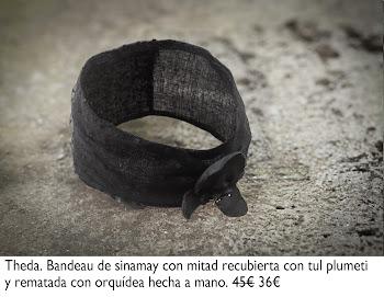 Bandeau negro de sinamay con mitad recubierta con tul plumeti y rematada con orquídea hecha a mano