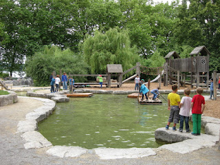 Children rafting on a playground lake, Mainau, Germany