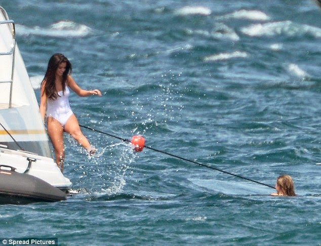 Selena Gomez spotted in a white swimsuit on yacht in Saint Tropez with Cara Delevingne