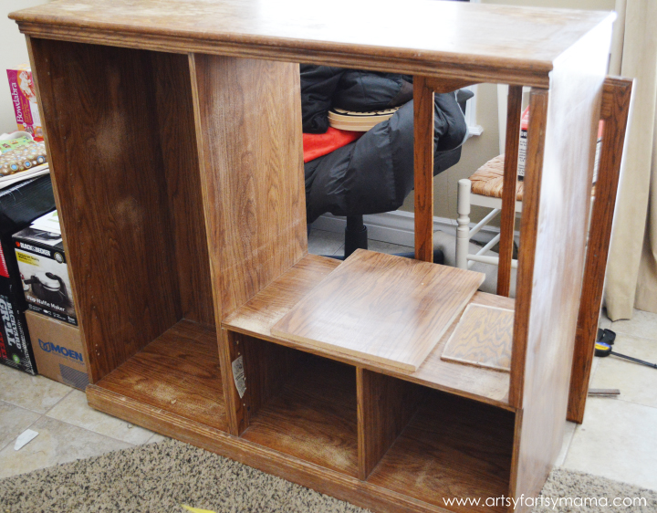 Entertainment Center to DIY Dollhouse & Dress-Up Cabinet from artsyfartsymama.com #upcycle #dollhouse #Barbiehouse