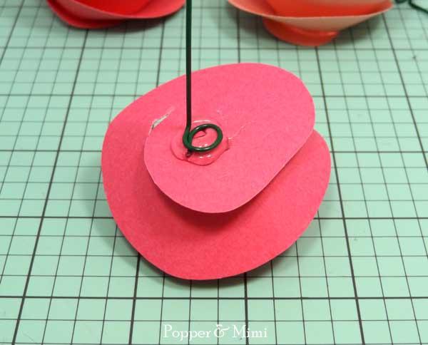 Glue floral wire to paper flowers   popperandmimi.com