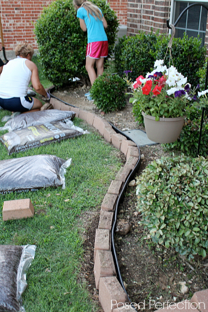 Putting Mulch into the Flower Bed