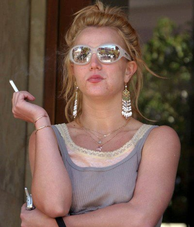 Britney Spears smoking a cigarette (or weed)