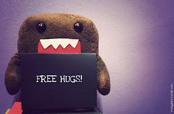 ¡ FREE HUGS ! - les abraza -