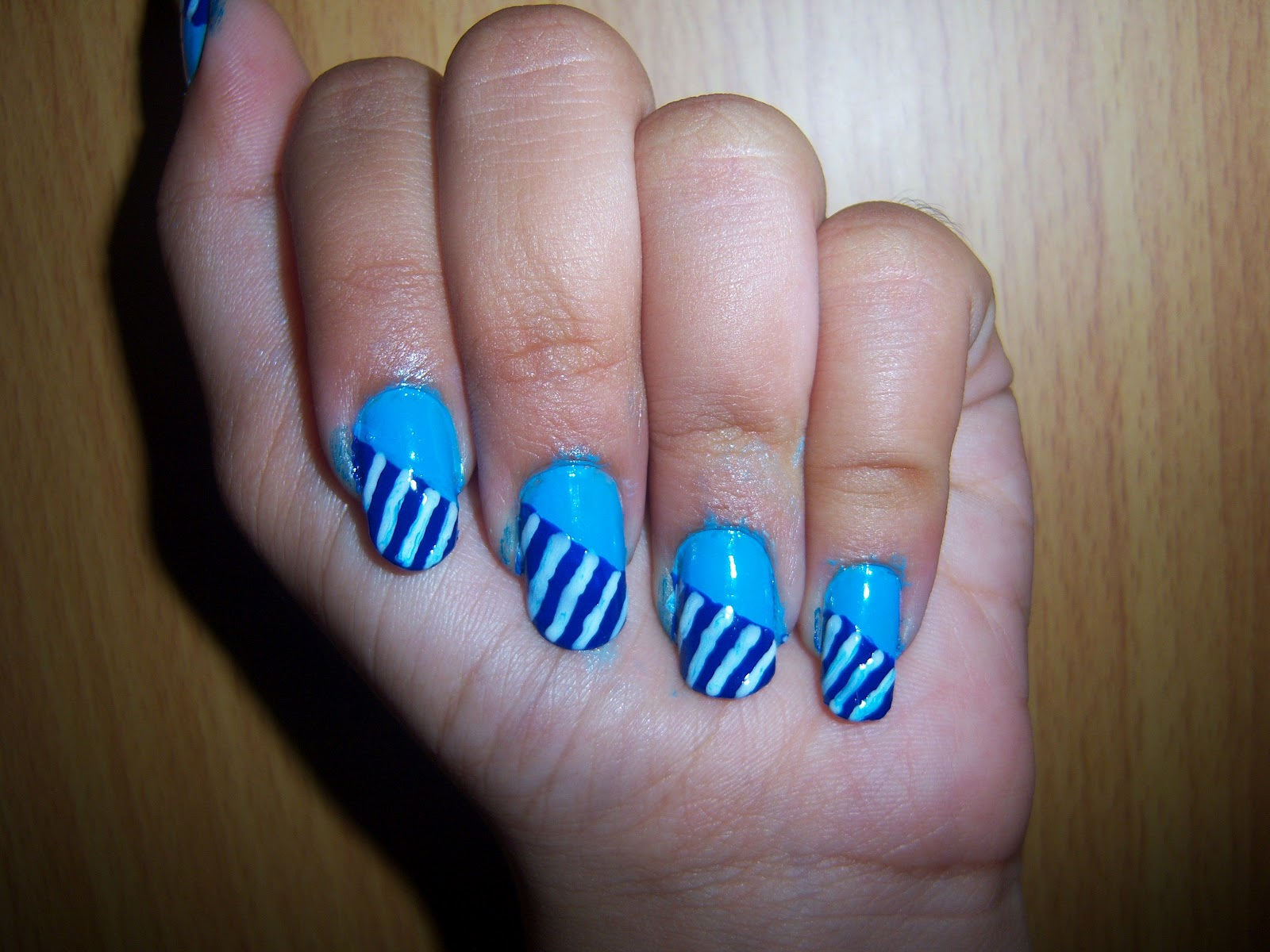Saipriya Patel Blue Striped Nail Art Design