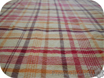Recycling a tablecloth into kitchen towels