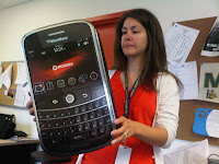 Kijiji woman holds giant Blackberry Bold
