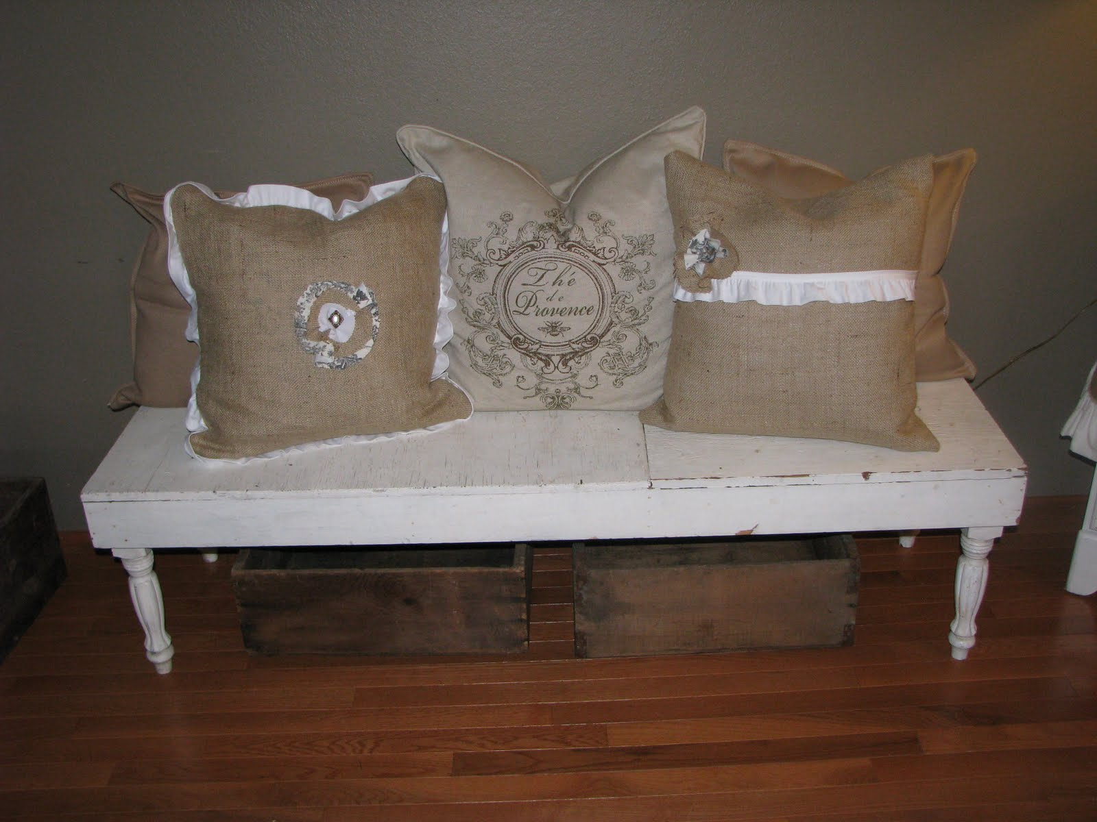 this is the final resting spot for my two new burlap pillows the bench i picked up at an estate sale for a year or so ago
