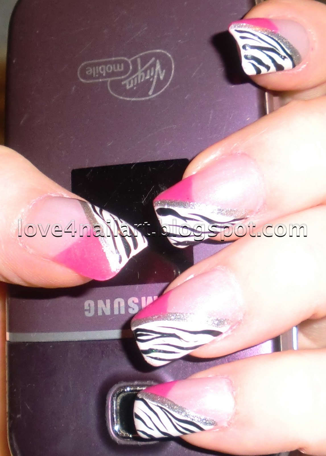 Hot pink and black zebra nails