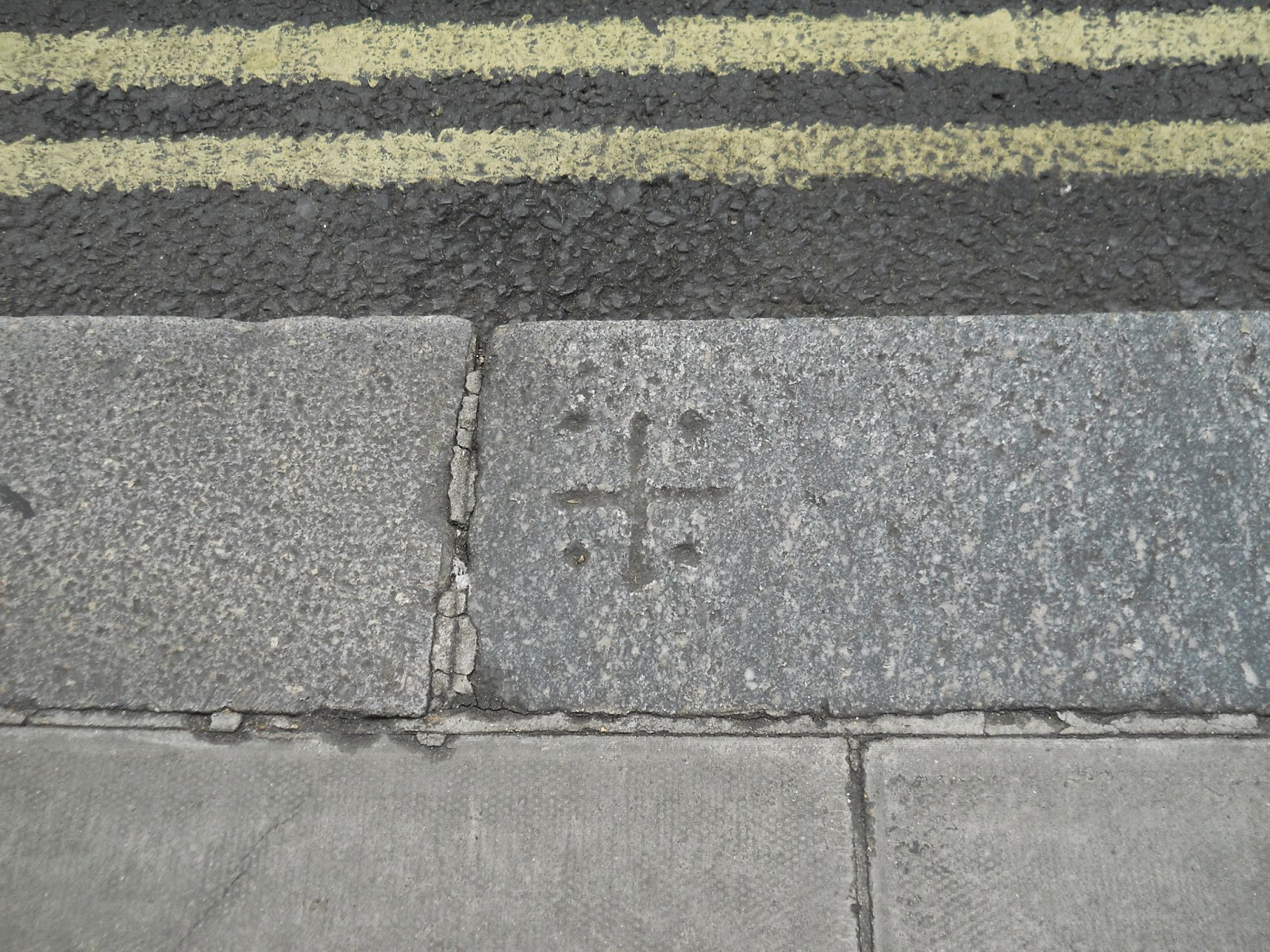 The mysterious carved symbols on kerbstones of london