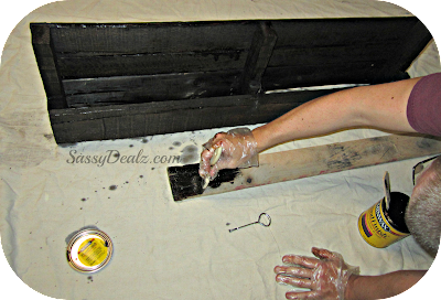 staining the wood pallet for making the wine rack