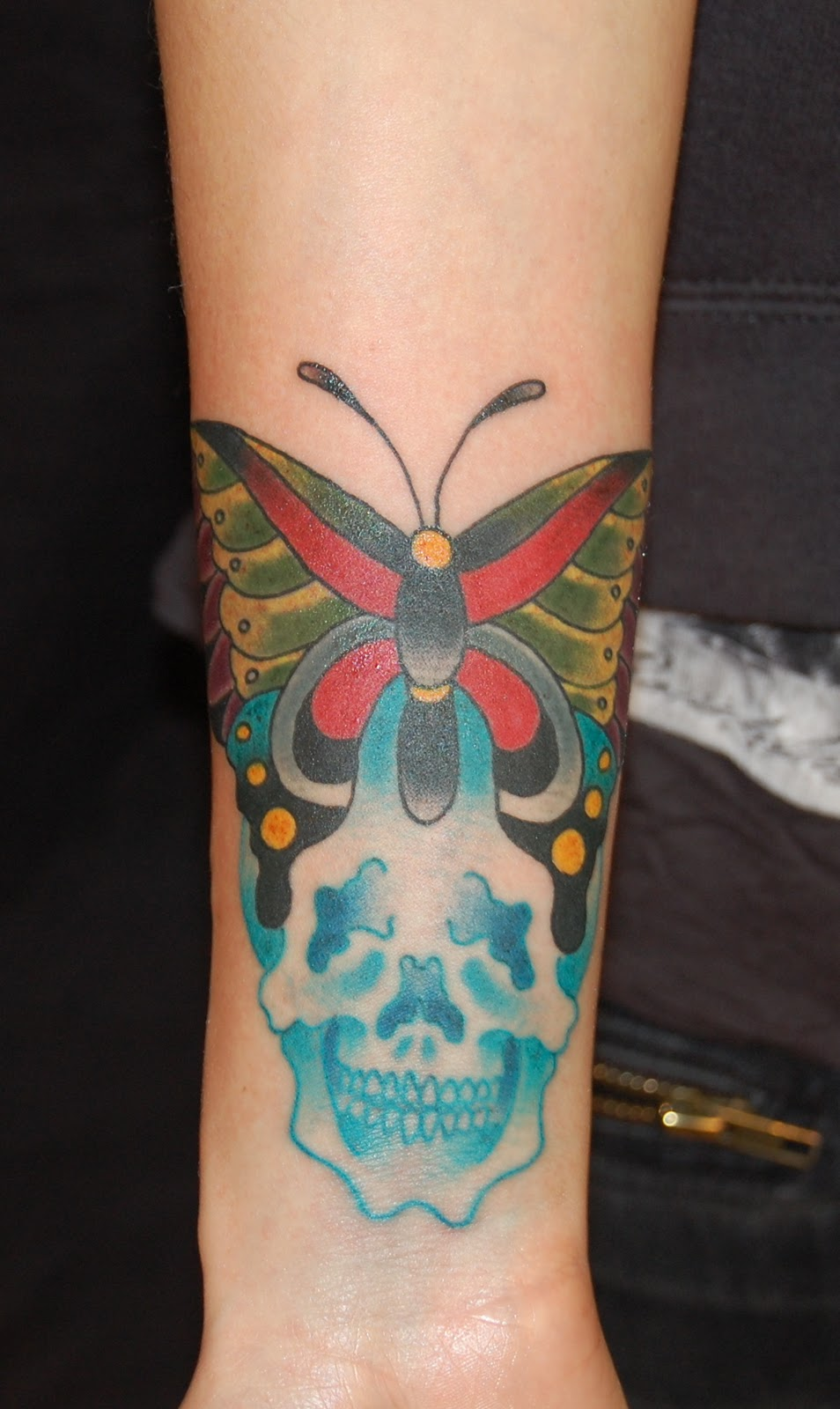 Jeb maykut flyrite tattoo a moth and skull tattoo on for Mf doom tattoo