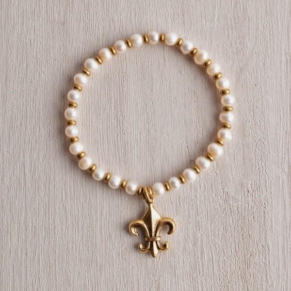 http://www.whitetrufflestudio.com/collections/bracelets/products/white-truffle-fleur-de-lis-pearl-bracelet
