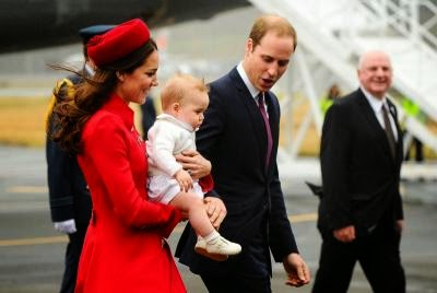 Catherine (L), carrying baby Prince George,