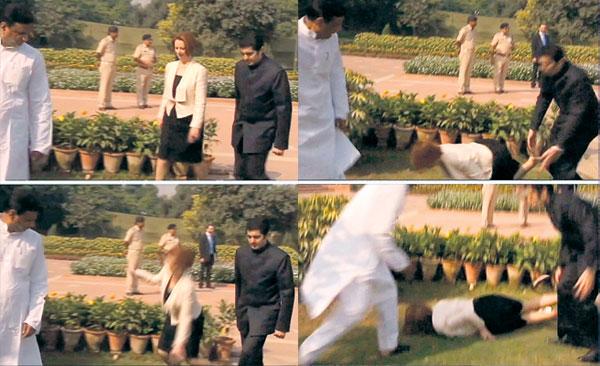 KOMBINASI gambar menunjukkan detik-detik Gillard terjatuh di Memorial Mahatma Gandhi, New Delhi kelmarin.