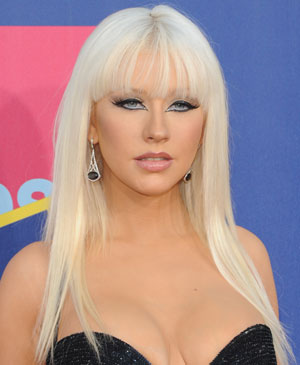 Christina Aguilera's super-straight strands have bold face-framing layers and piece-y bangs.