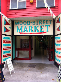 Exterior shot of Wood Street Market signage