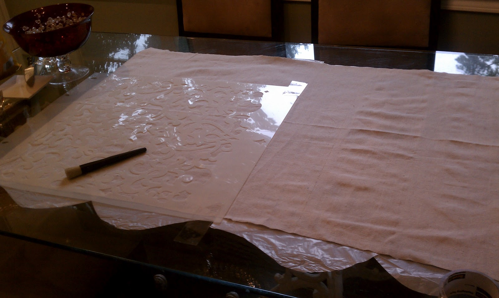 wash and iron the drop cloth and lay it out on a large work surface make sure you lay down some cardboard or plastic so that your work surface will be