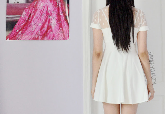 Back view of the romantic white sheer mesh polka dot fit-and-flare skater dress from Yumart.