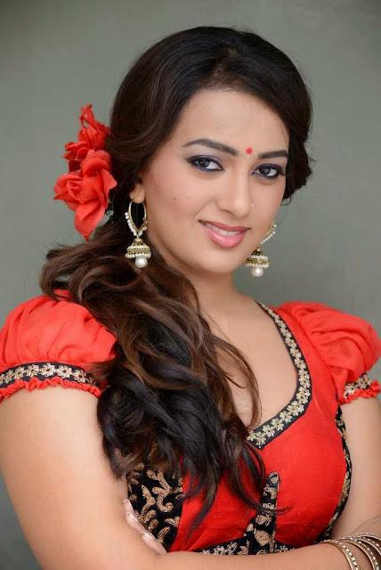 Ester Noronha Stills in Red Saree